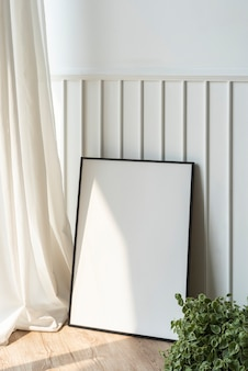 Blank picture frame on parquet floor