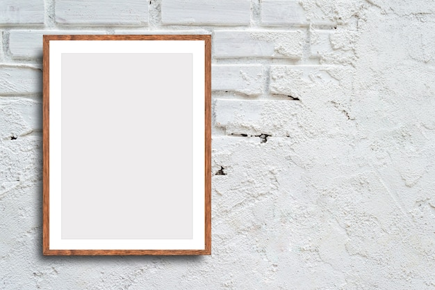 Blank picture frame on white brick wall