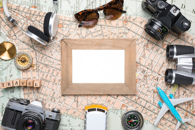 Blank picture surrounded by travel elements