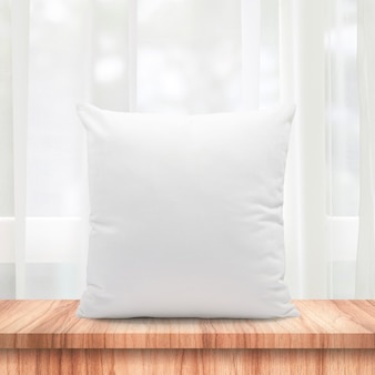 Blank pillows made from soft feather on morning window and curtains