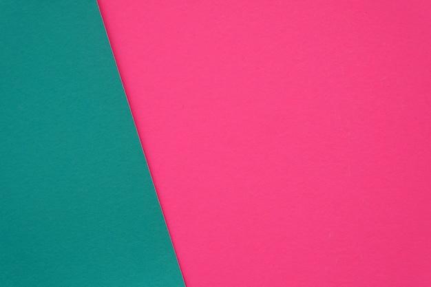 空白のピンクと緑の紙のテクスチャの背景