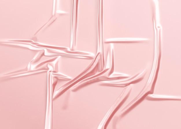 空白のピンクのしわくちゃのプラスチックホイルラップオーバーレイモックアップ空の使い捨てストレッチストレージフィルムモックアップ