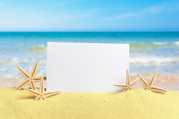 Blank placard on sand