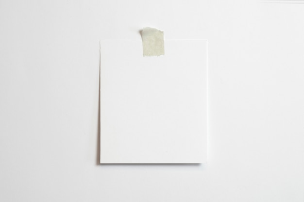 Blank polaroid photo frame with soft shadows  and scotch tape isolated on white paper background