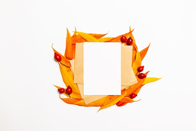Blank post mail envelope mock up with autumn yellow and red leaves