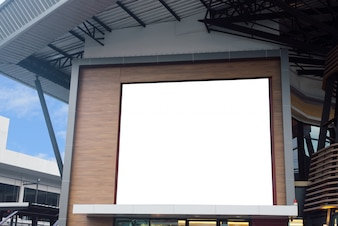 Blank poster billboard wall with copy space for your text message or content in modern shopping mall on a cloudy day.