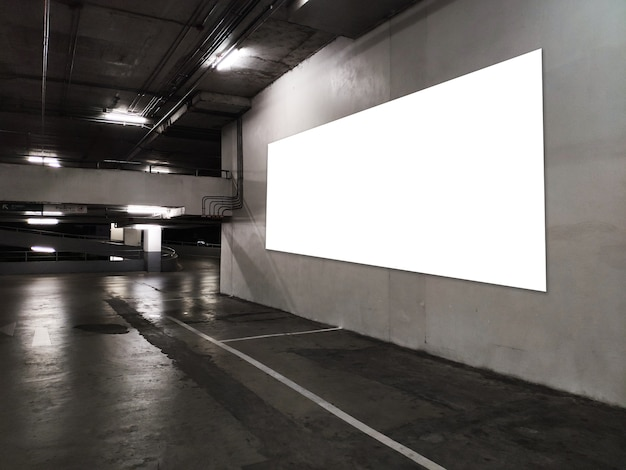 Blank poster display promotion at underground parking lot.