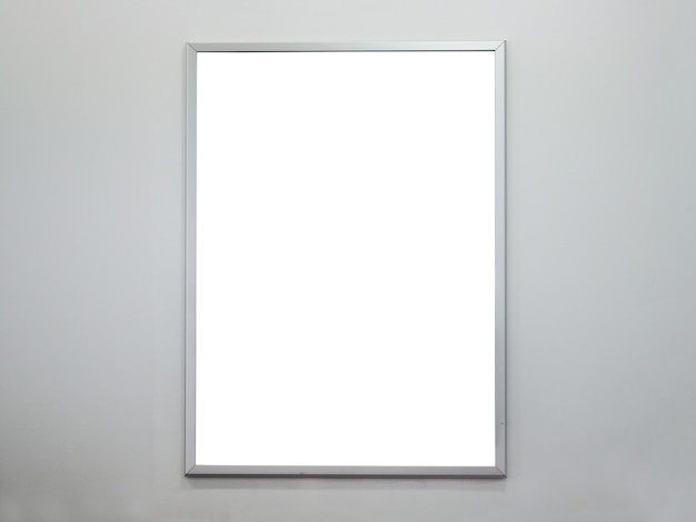 Blank poster frame on concrete wall