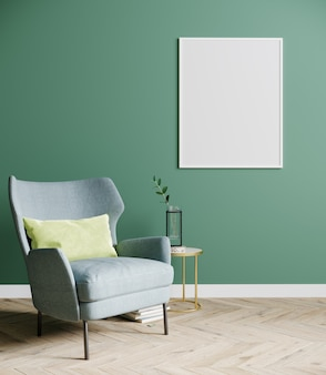 Blank poster frame in empty bright modern living room mock up with blue armchair and coffee table