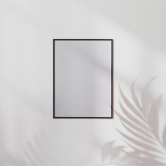 야자수 잎 그림자, 3d 그림이 있는 흰색 벽에 빈 포스터 프레임이 조롱됩니다.