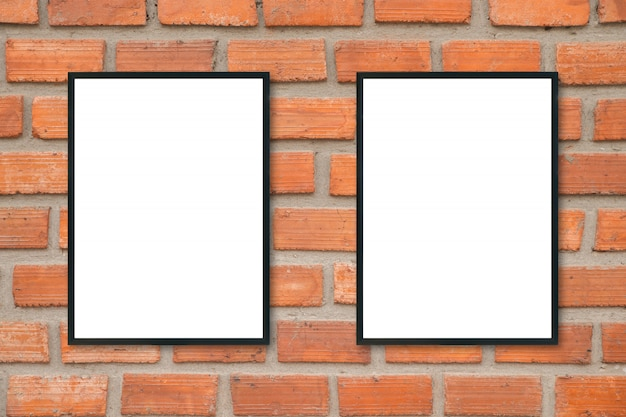 Blank poster picture frame on brick wall.