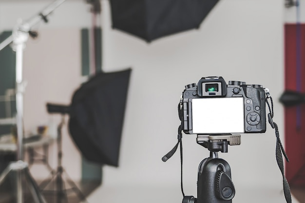 Blank of a professional camera, in a photo studio, against the softbox light sources.