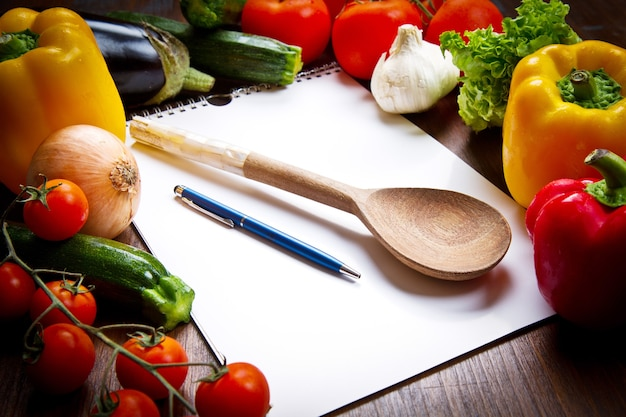 Blank recipe book and food ingredients