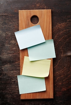 A blank recipe cards (or shopping list) on a kitchen board