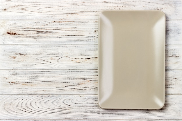 Blank rectangular plate on wooden. top view