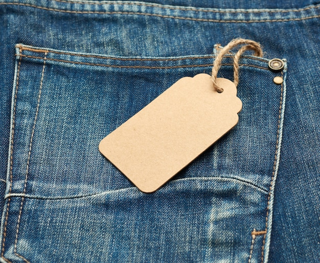 Blank rectangular tag tied on the back pocket of jeans