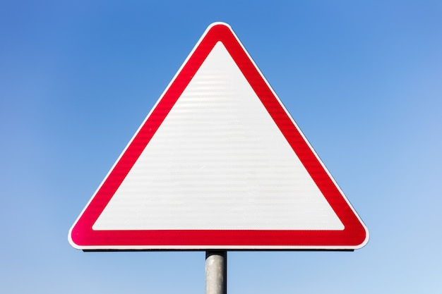 Blank road sign on blue sky.