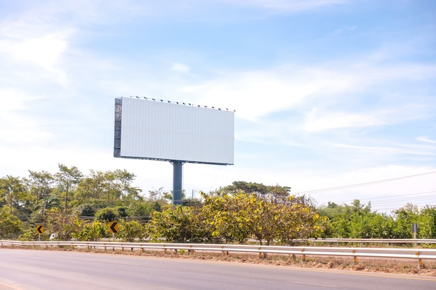 Blank roadside billboard on a bright sunny blue sky day with area for your message