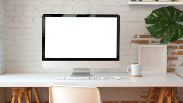 Blank screen desktop computer in minimal office room
