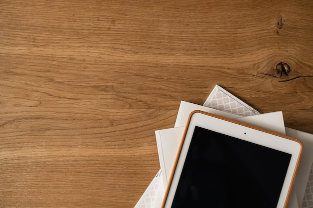 Blank screen display on wooden table