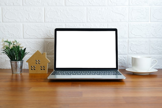 Blank screen laptop computer on deck, workplace with laptop on table at home,work form home concept
