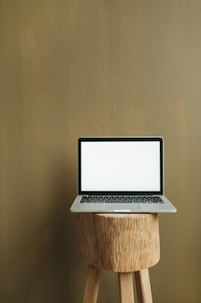 Blank screen laptop on olive