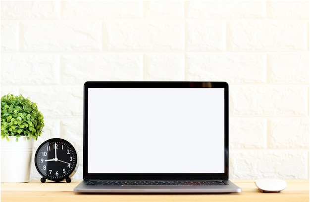 Blank screen laptop on wooden table at home office