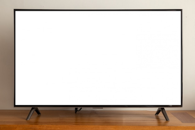Blank screen led television on wood table.