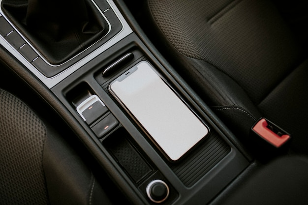 Blank screen mobile phone inside a car