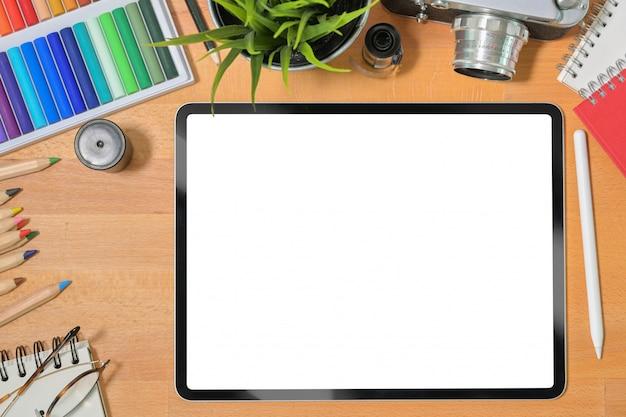 Blank screen mockup tablet on creative designer workspace desk