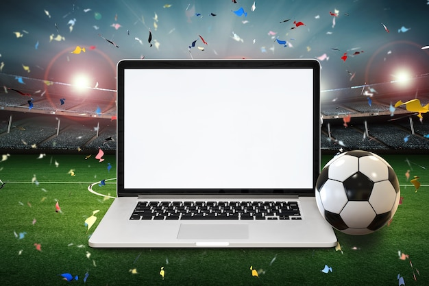 Blank screen notebook with 3d rendering soccer ball and soccer stadium background