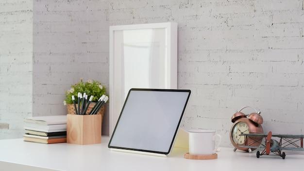 Blank screen tablet in minimal office style