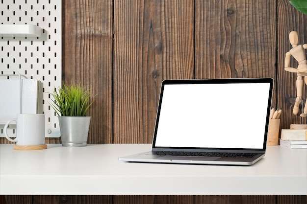 Blank screen tablet on modern minimalist desk workspace table and copy space