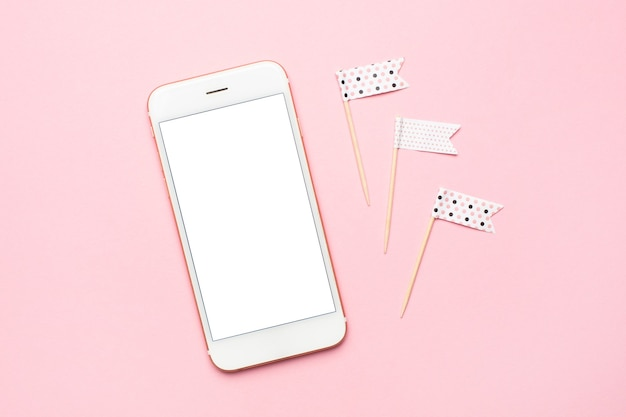Blank screen white cellphone on pastel pink