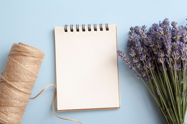 Blank sheet of flat lay notebook with lavender, twine.