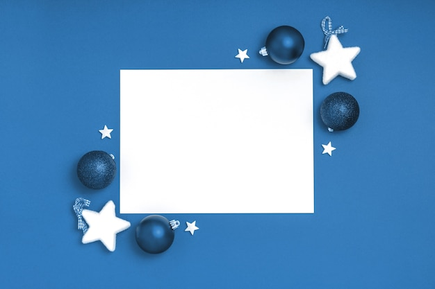 Blank sheet of paper with christmas decorations