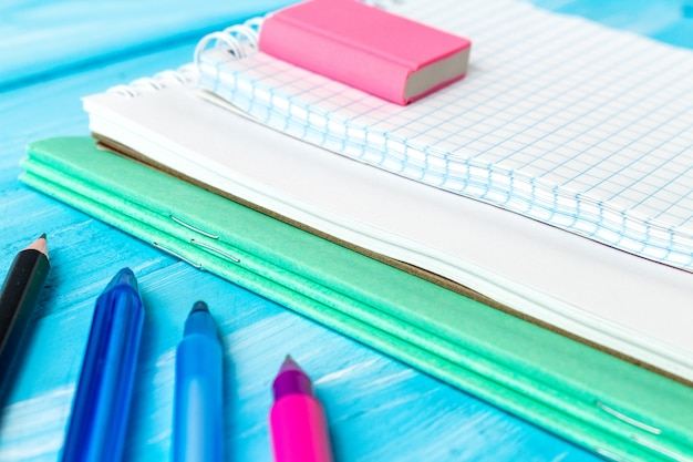 Blank sheets of notebook with blue pens and pencil. back to school concept.