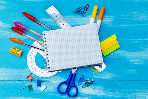 Blank sheets of notebook with office supplies pens, pencils, rulers, markers. back to school concept.