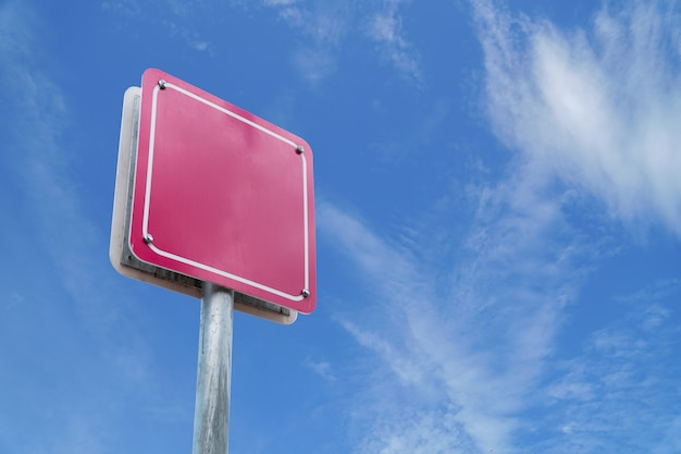 Blank sign pink wite blue sky.