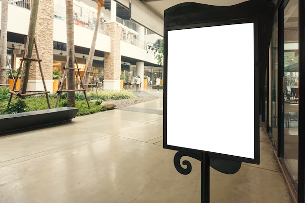 Blank sign with copy space for your text message or mock up content in modern shopping mall.