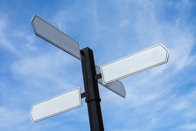 Blank signs pointing in opposite directions