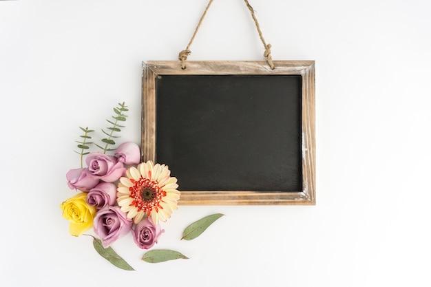 Blank slate with beautiful flowers