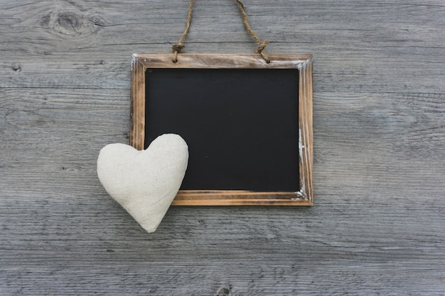 Blank slate with decorative heart