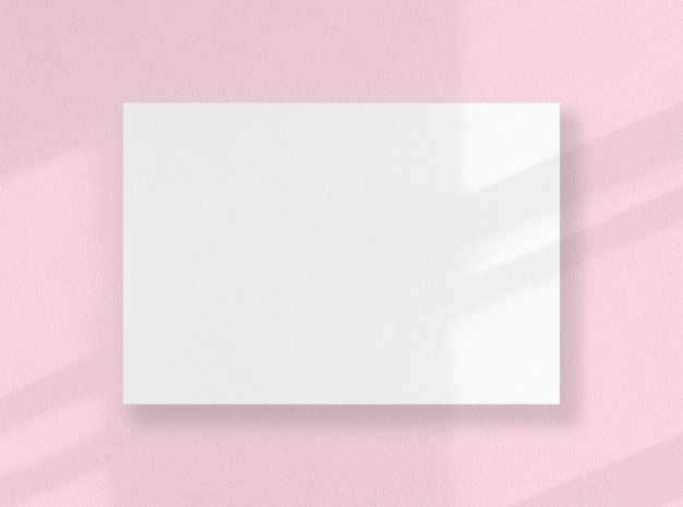 Blank square card, white sheet as mockup with sunny shadows on pink surface