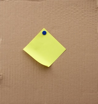 Blank square sheet of paper attached with an iron button