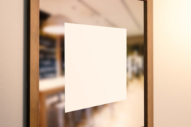 Blank square sign on glass door