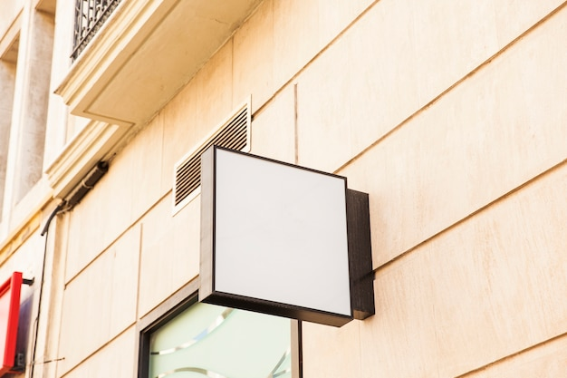 Blank square sign on wall