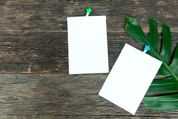 Blank squared notepad pages and the paper clip. note paper stuck with paper clip.