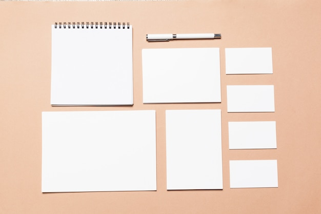 Blank stationery, business cards, papers, documents, pen