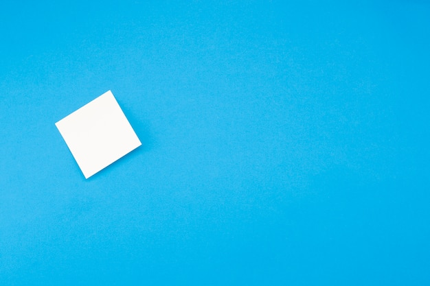 Blank sticker isolated on blue background with copyspace